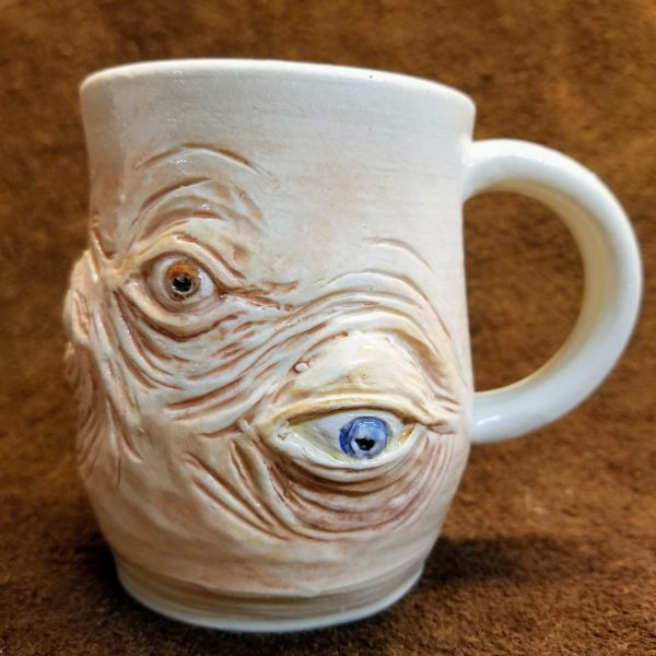Handmade pottery horror mug with eyes