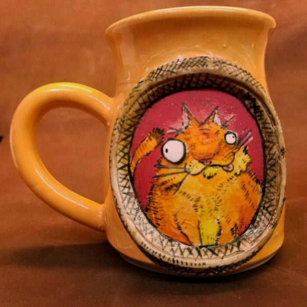 Handmade Handpainted Pottery mug featuring a goofy ginger orange cat in a frame