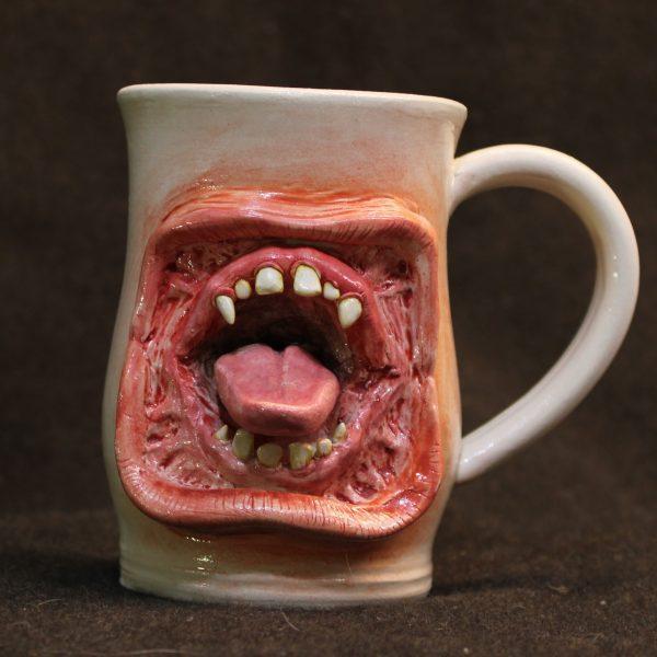 Large gaping lips mouth mug made of white porcelain