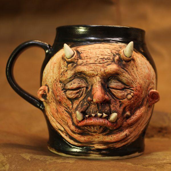 Handmade pottery graphic sleeping demon mug