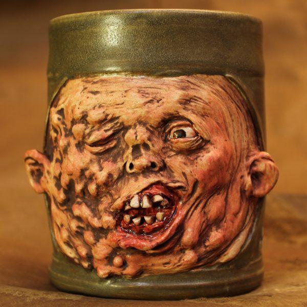Handmade pottery body horror face-melting mug