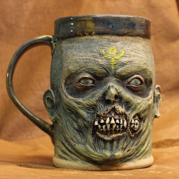 Highly realistic handmade blue zombie pottery mug